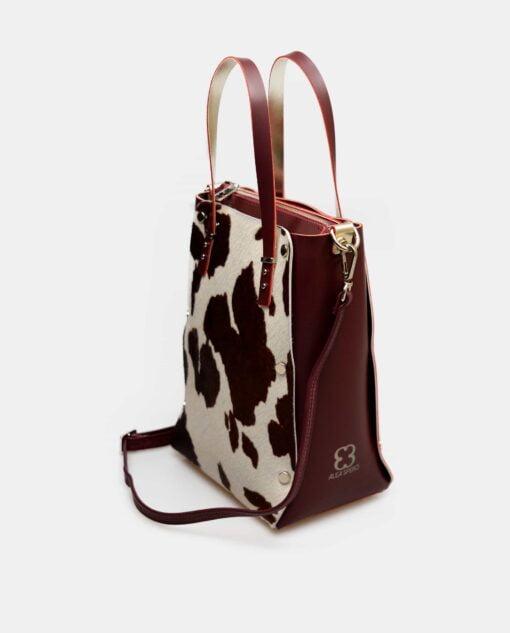 bolso de piel lisa combinada con pelo de vaca lateral